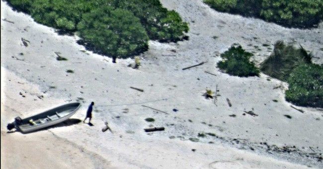 'SOS' in sand leads to rescue of 2 people stranded on island