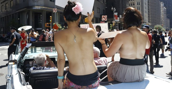 The Latest: Women march for topless rights in Los Angeles
