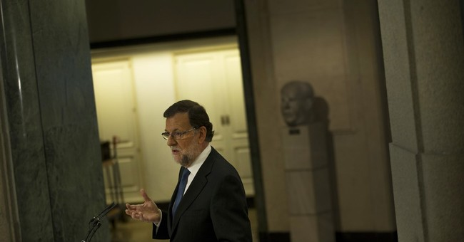 Spanish conservatives sign deal with smaller party