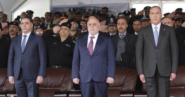 Down another key minister, Iraq continues Mosul push