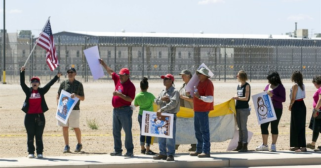 The Latest: Immigrant advocates want private contracts gone