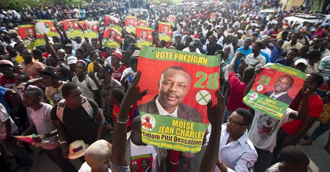 Aristide joins Haiti rally to urge voters to back candidate
