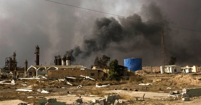 Oil wells south of Mosul burn days after key town retaken