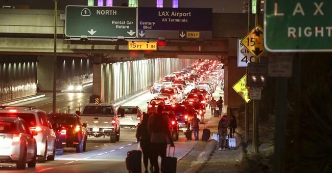 The Latest: Investigators focus on 911 call before LAX panic