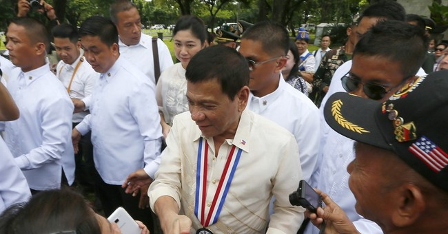 Philippine president says no genocide in his bloody drug war