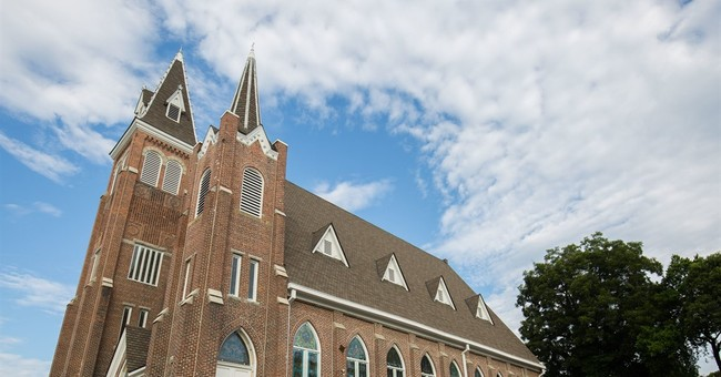 Neighbor churches, split on race lines, work to heal divide