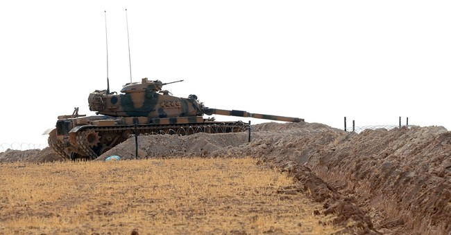 Uneasy truce holds between Syrian Kurds, Turkey