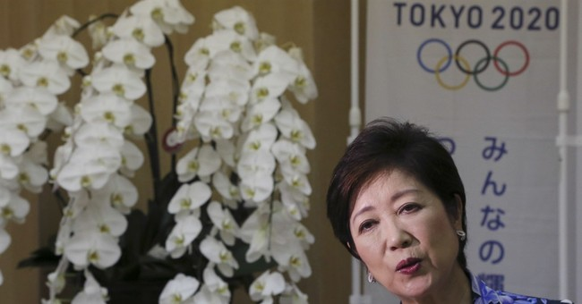 AP Interview: Tokyo leader vows Olympics, policy leadership