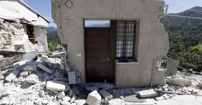 Quake survivors erupt in anger at funeral plan; govt relents