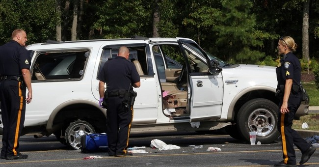 1 dead, 4 hurt in highway shootout; bullet holes cover SUV
