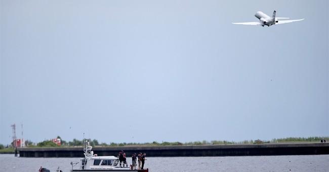 Crews to retrieve plane from lake; 2 men still missing