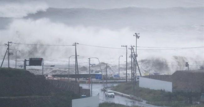 Rivers swollen by Typhoon Lionrock flood in northern Japan
