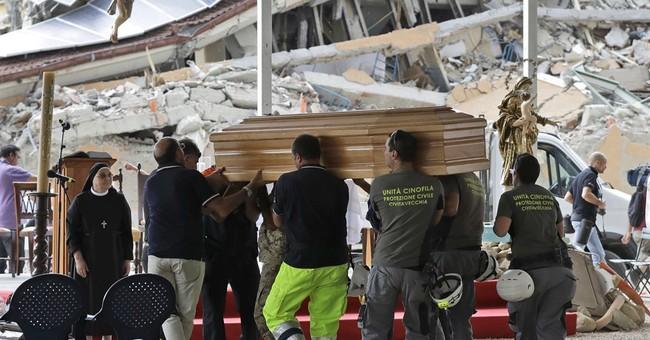 Italy honors quake victims as bishop warns of reconstruction