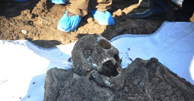 AP documents 72 mass graves left by IS militants