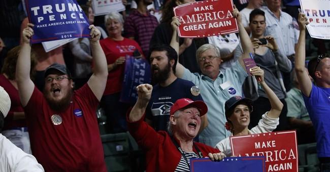 The Latest: Trump says immigrants taking minorities' jobs