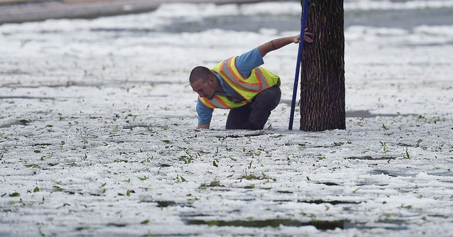 Colorado city sends snowplows to clean up heaps of hail