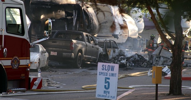 The Latest: Catastrophe averted in fatal Sparks plane crash