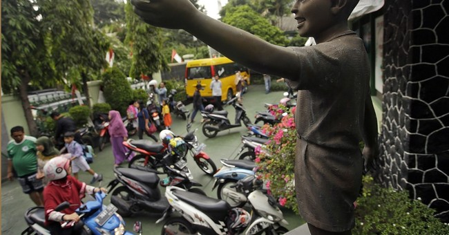 Indonesians keep pride in Obama link even as high hopes dim