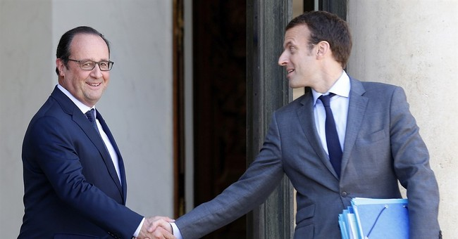 France's Macron seeks new horizon, hints at presidential bid