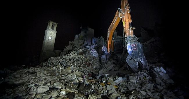 The Latest: Renzi names official to rebuild quake-hit area