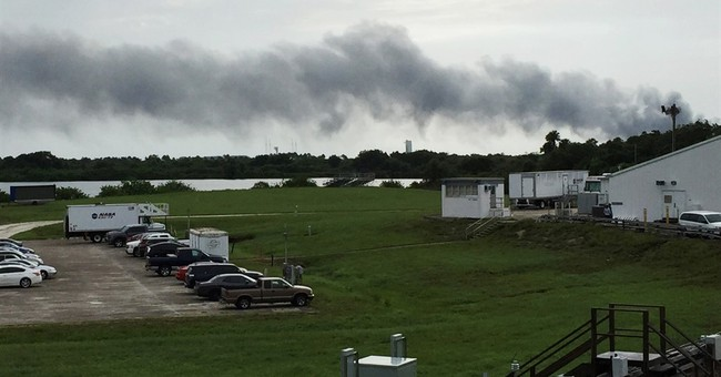 Explosion at SpaceX launch pad destroys rocket, satellite