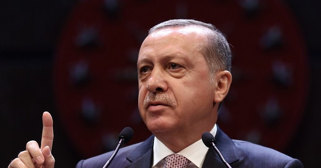 Turkey's president defends his massive post-coup crackdown