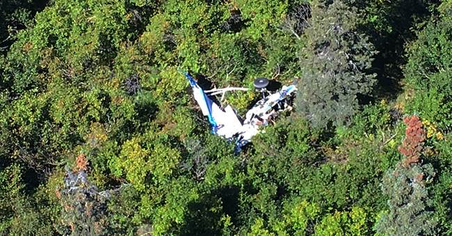Rough terrain complicates efforts to recover bodies in crash
