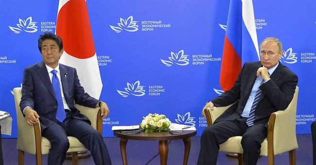 Russia's Putin meets Japanese PM to discuss peace deal