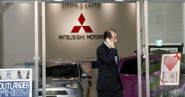 Japan raids Mitsubishi Motors over mileage-cheating scandal