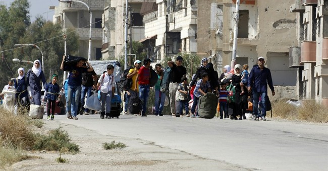 The Latest: UN says no deal with Jordan on stranded Syrians