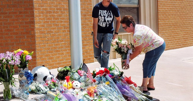 The Latest: Lawmakers express condolences in officer's death
