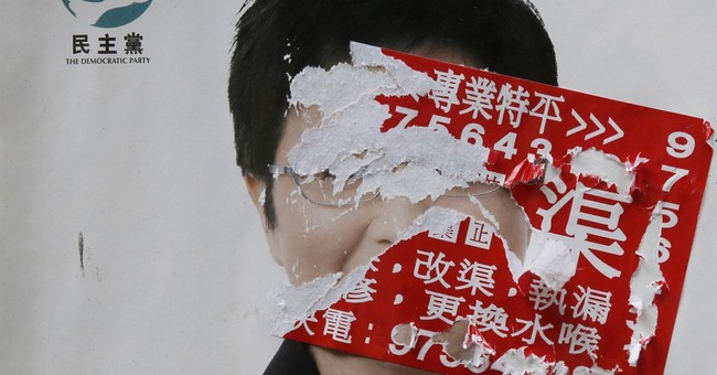 AP PHOTOS: Vandalized posters ahead of Hong Kong's elections