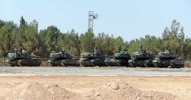 The Latest: Turkey says IS driven from Turkish-Syrian border