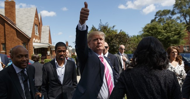 Trump tells black congregation he wants to fix 'many wrongs'