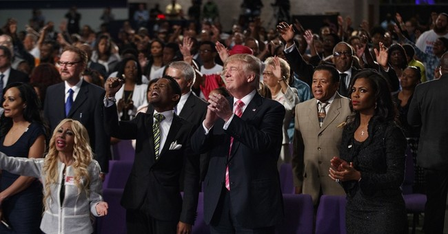 Trump tells black churchgoers in Detroit visit is 'to learn'