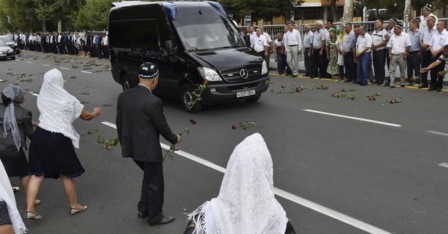 Harsh Uzbek leader buried amid praise from his Cabinet