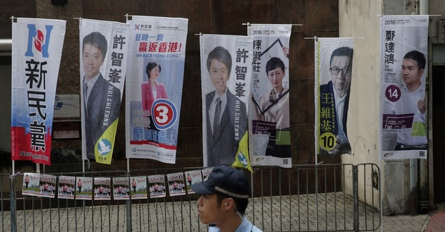 The Latest: High turnout in Hong Kong election