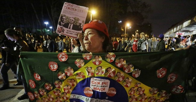 Brazilian police clash with protesters rejecting new leader