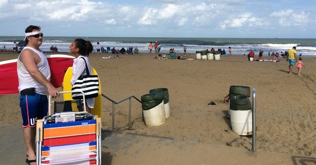 Hermine lingers offshore, brings rough waves, rip currents