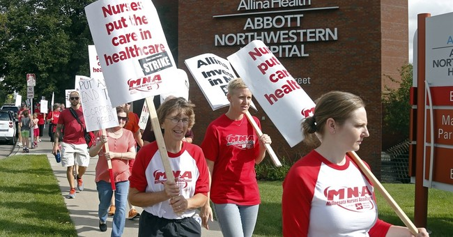 Nurses hit picket lines in strike at 5 Minnesota hospitals