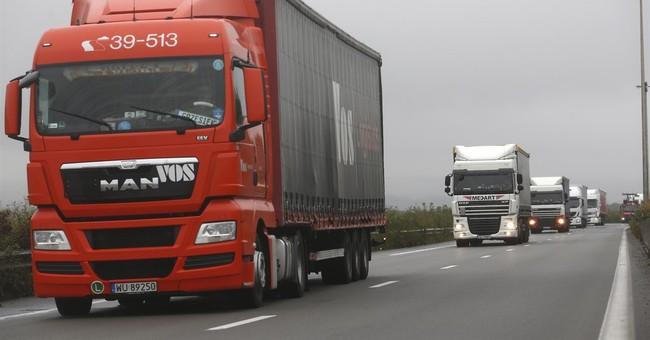 Protesters, seeking migrant camp closure, block Calais roads