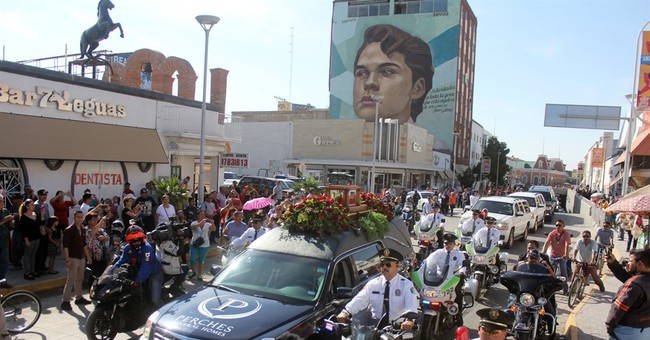 Mexico's capital pays last farewell to singer Juan Gabriel
