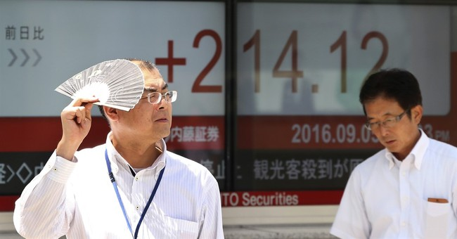 Asian shares edge higher in dull trading as US takes holiday