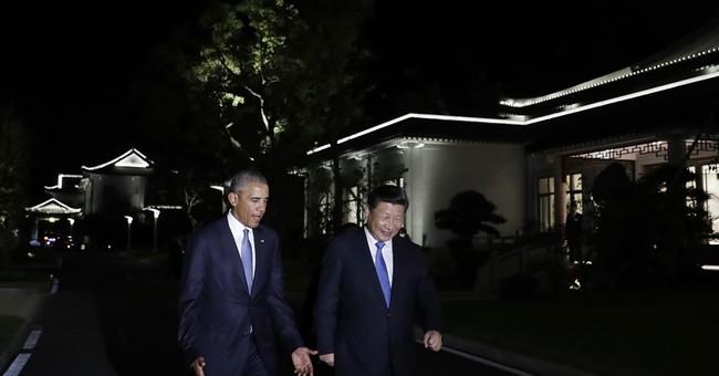 China tamps down South China Sea talk at summits