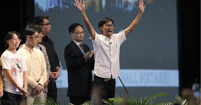 Hong Kong pro-democracy candidates retain veto in key vote