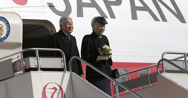 Japan's emperor visiting the Philippines, a former WWII site