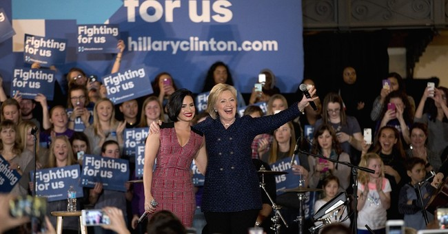 Clinton courts youth with celebs, but many prefer Sanders