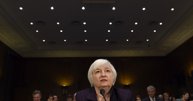 A month after raising rates, Fed faces darker global economy