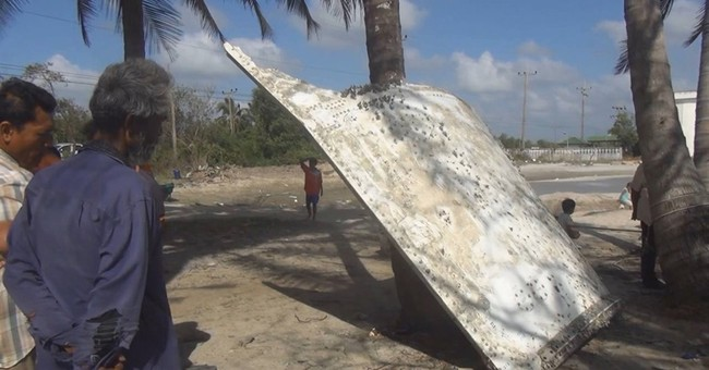 Malaysia says metal on Thai beach not from Flight 370