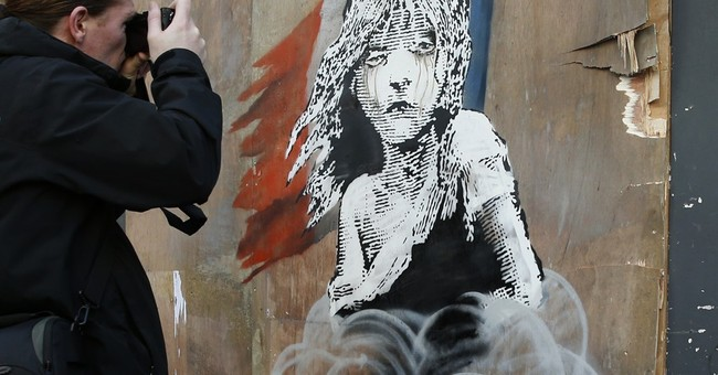 Street artist Banksy takes swipe at France on migrant crisis